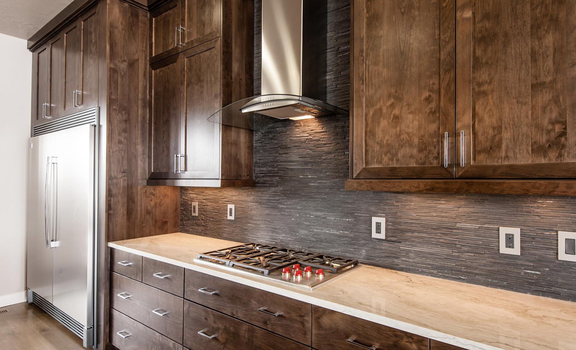 The Corrente Bello House Kitchen Stovetop and Refrigerator