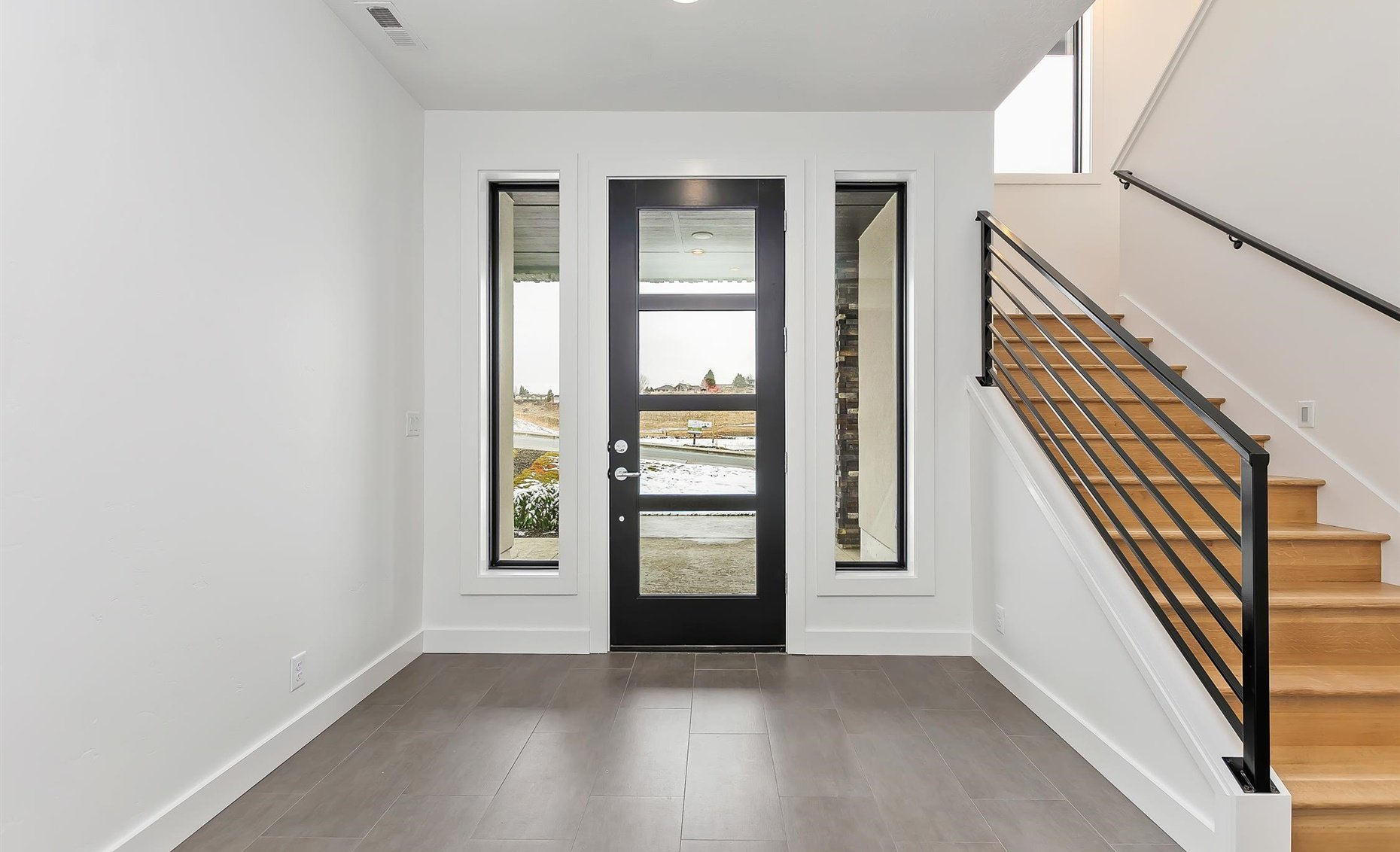 East Highland | Entryway front door and staircase