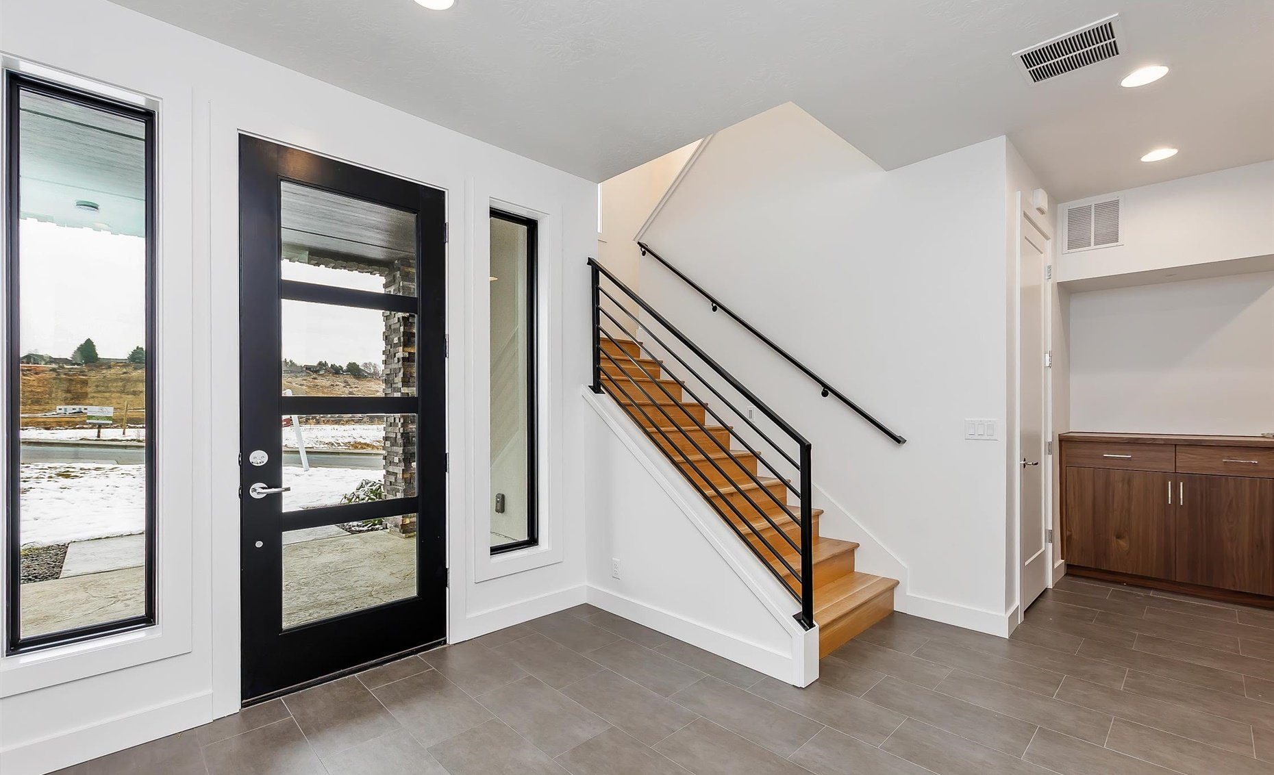 East Highland | Entryway, frontdoor, and staircase
