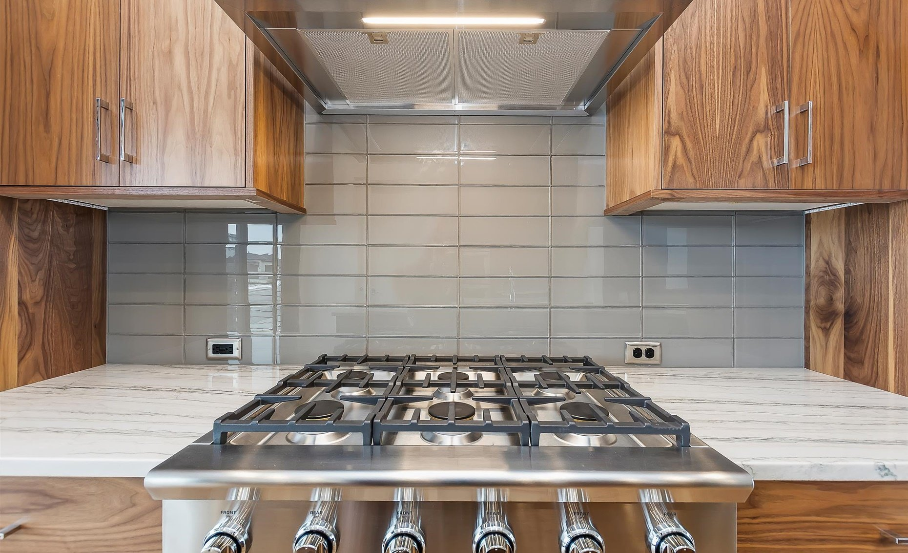 East Highland | Kitchen cabinetry, stove, and fixtures