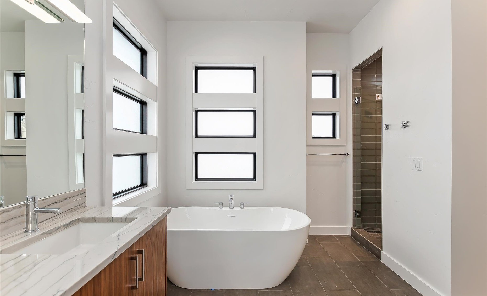 East Highland | Master bathroom shower and bathtub