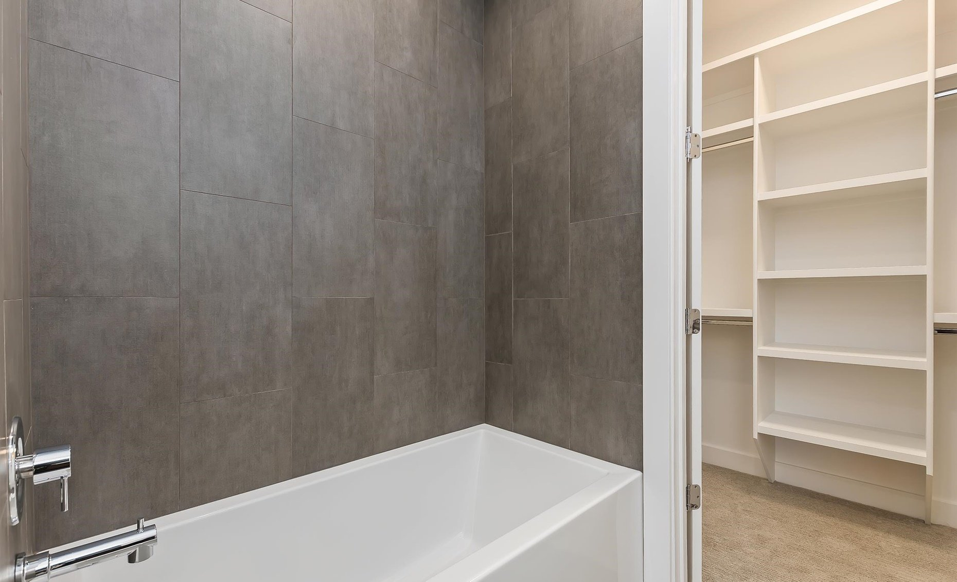 East Highland | Guest bathroom with tub and closet