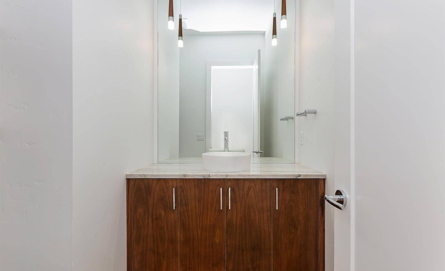 East Highland | Guest bathroom sink with modern fixtures